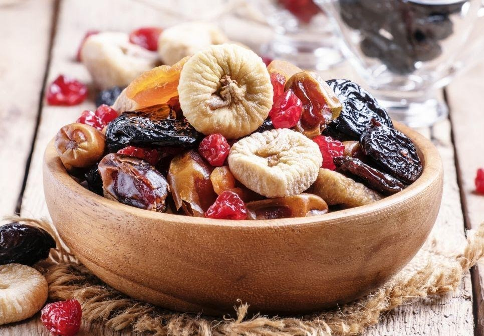 Jaybee's Nuts Dried fruit in a brown, wooden, bowl